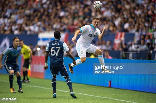 Seattle Sounders forward Jordan Morris jumps for the ball ahead of Vancouver Whitecaps forward Alphonso Davies during their match at BC Place on...