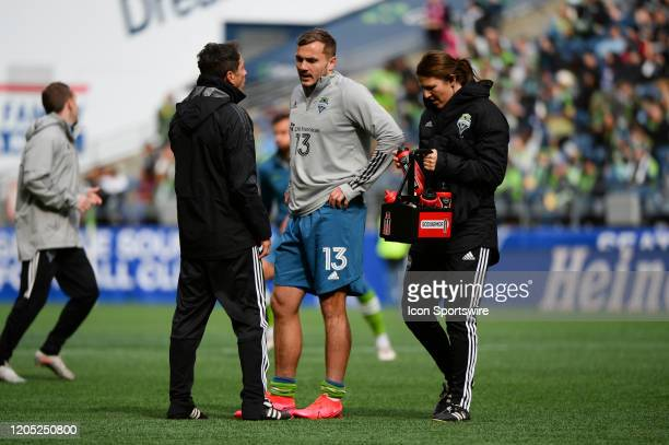 Seattle Sounders forward Jordan Morris talks with assistant coach Gonzo Pineda at halftime of a MLS match between the Chicago Fire and the Seattle...