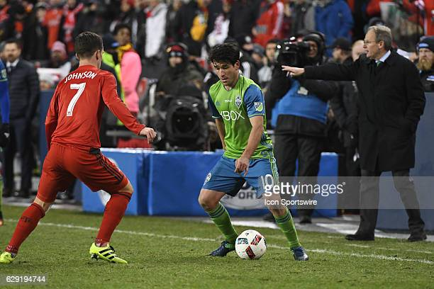 Seattle Sounders Forward Nicolas Lodeiro is defended by Toronto FC player Will Johnson during the MLS Cup final game between the Seattle Sounders and...