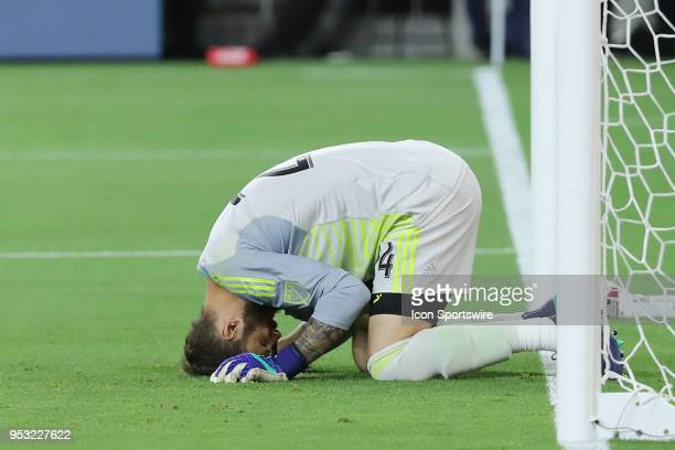 Seattle Sounders goalkeeper Stefan Frei bows in shock after missing on an easy save opportunity in extra time in the game between the Saettle...
