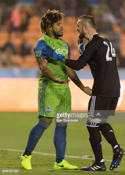 Seattle Sounders goalkeeper Stefan Frei chastises Seattle Sounders defender Roman Torres during the MLS opening match between the Seattle Sounders...