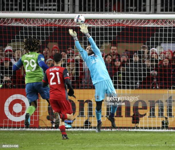 TORONTO ON DECEMBER 9 Seattle Sounders goalkeeper Stefan Frei makes a save as Toronto FC midfielder Jonathan Osorio looks for a rebound as the...