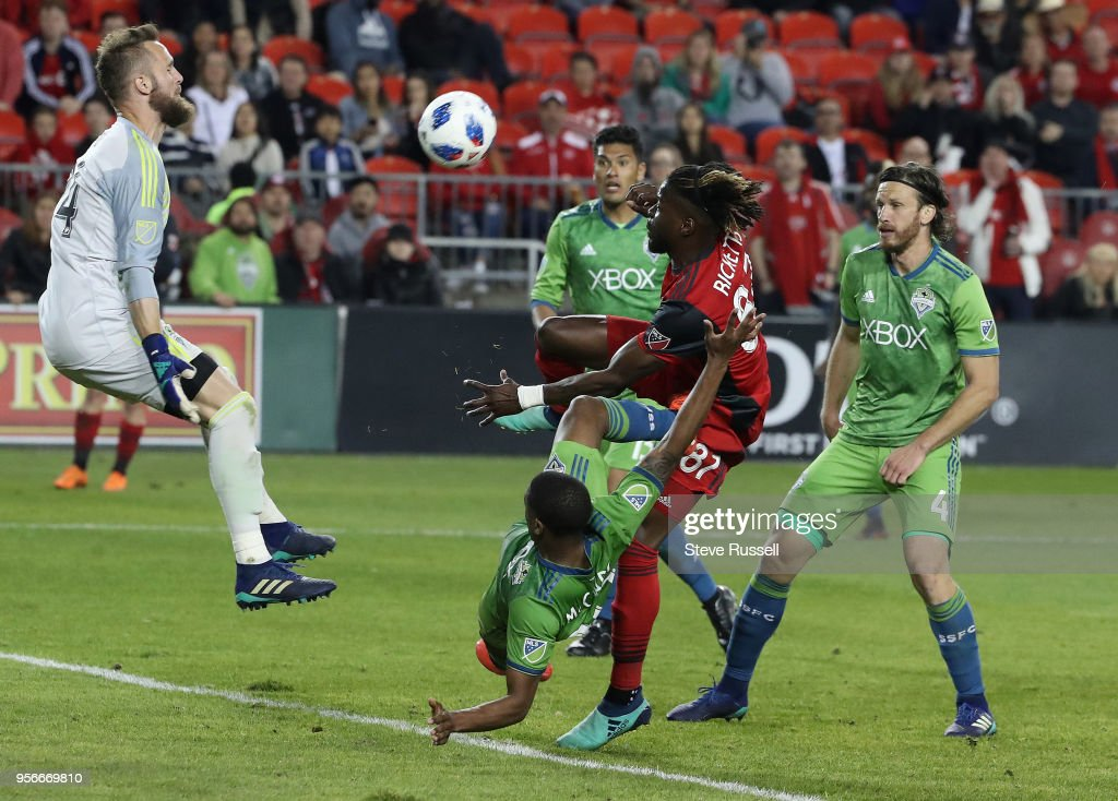 TORONTO, ON- MAY 9 - Seattle Sounders goalkeeper Stefan Frei (24) stops Toronto FC forward Tosaint Ricketts (87) in injury time as Toronto FC falls to the Seattle Sounders 2-1 at the BMO Field in Toronto. May 9, 2018.
