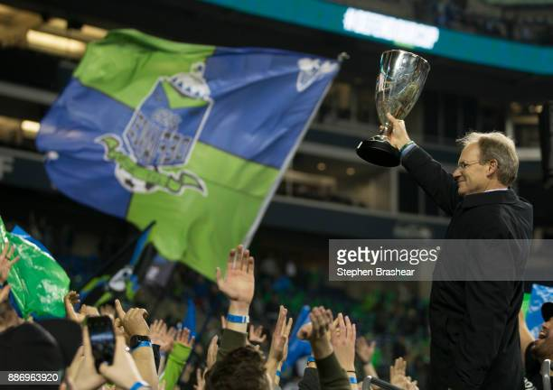Seattle Sounders head coach Brian Schmetzer hoists the championship trophy after the second leg of the MLS Western Conference Finals against the...