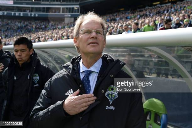 Seattle Sounders head coach sings the national anthem before a MLS match between the Chicago Fire and the Seattle Sounders at Century Link Field in...