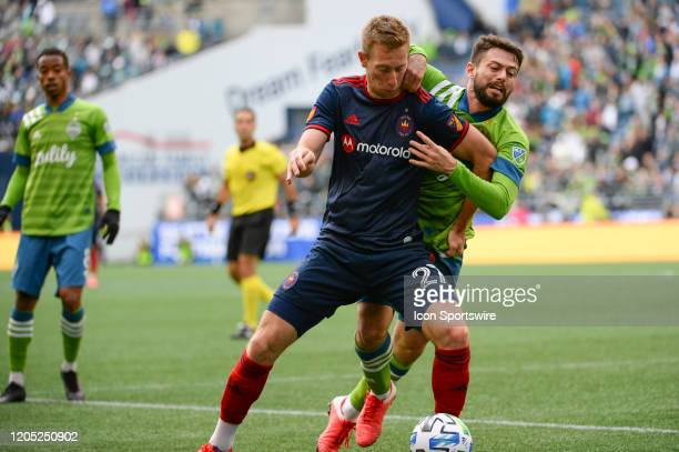 Seattle Sounders midfielder Joao Paulo defends against Chicago Fire forward Robert Beric during a MLS match between the Chicago Fire and the Seattle...