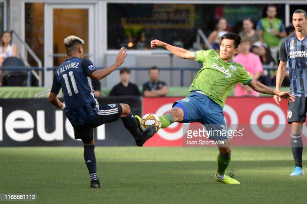 Seattle Sounders midfielder Kim KeeHee and Los Angeles Galaxy forward Favio Alvarez challenge for the ball during an MLS match on September 1 at...