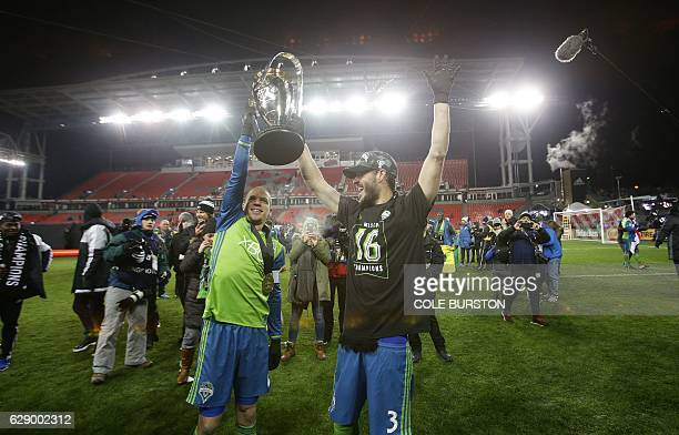 Seattle Sounders midfielder Osvaldo Alonso and Seattle Sounders forward Brad Evans celebrate with the MLS cup after their victory over Toronto FC at...