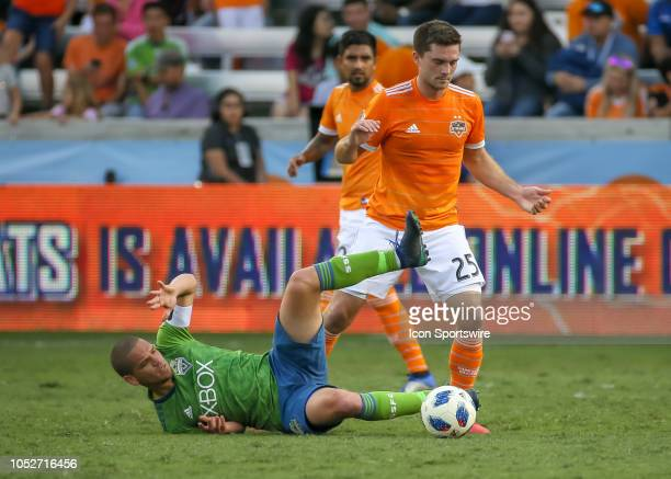 Seattle Sounders midfielder Osvaldo Alonso attempts to keep the ball away from Houston Dynamo midfielder Eric Bird during the soccer match between...