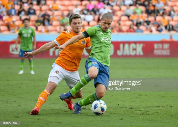 Seattle Sounders midfielder Osvaldo Alonso keeps the ball away from Houston Dynamo midfielder Eric Bird during the soccer match between the Seattle...