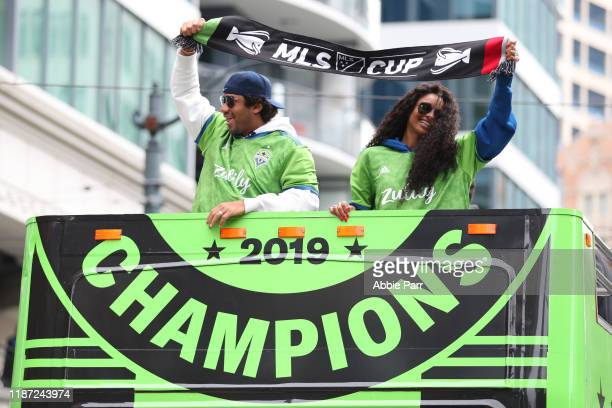 Seattle Sounders part owners Russell Wilson and Ciara show their support for the team during their MLS Cup victory parade on November 12 2019 in...