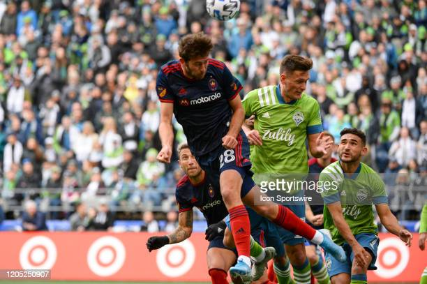 Seattle Sounders Shane O'Neill and Chicago Fire midfielder Elliot Collier go up for a free ball during a MLS match between the Chicago Fire and the...
