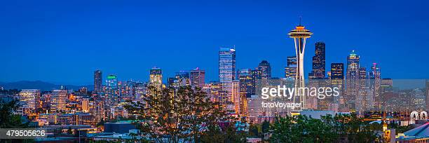 seattle space needle downtown skyscrapers illuminated dusk panorama washington usa - puget sound stock pictures, royalty-free photos & images