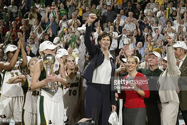 Seattle Storm coach Anne Donovan and the players celebrate a 7460 victory in the WNBA championships against the Connecticut Sun on October 12 2004 at...