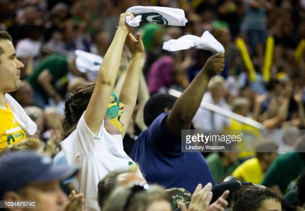 Seattle Storm fans cheer as their team takes on the Washington Mystics during the first half of Game 2 of the WNBA Finals at KeyArena on September 9...