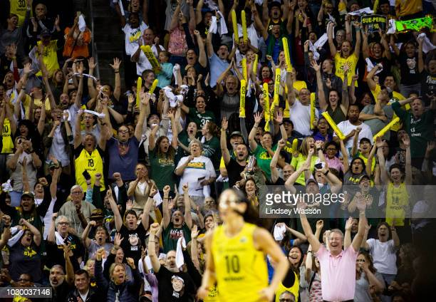 Seattle Storm fans erupt after Sue Bird of the Seattle Storm hit a threepointer from over 30 feet away against the Washington Mystics during the...