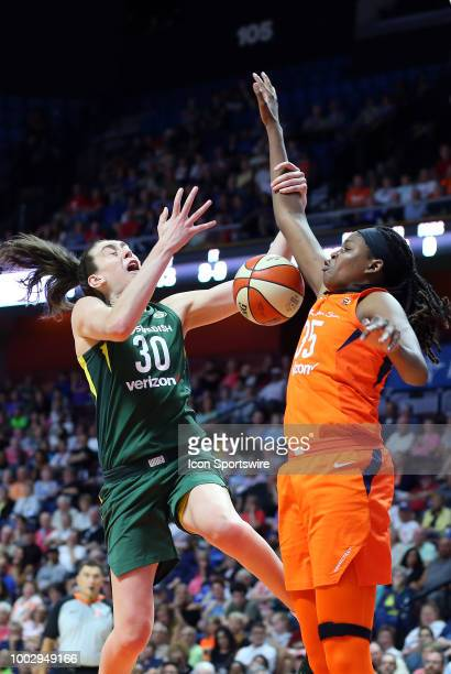 Seattle Storm forward Breanna Stewart fouled by Connecticut Sun forward Jonquel Jones during a WNBA game between Seattle Storm and Connecticut Sun on...