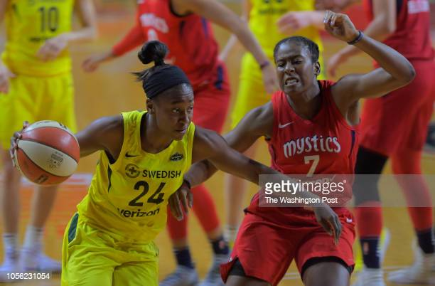 Seattle Storm guard Jewell Loyd tries to make her way past Washington Mystics guard Ariel Atkins during Game 3 of the WNBA Finals between the...