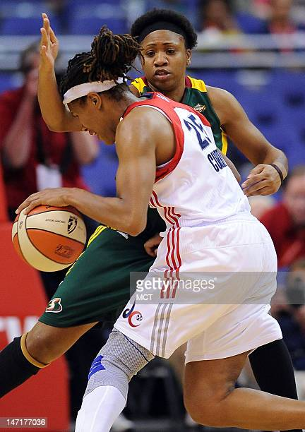 Seattle Storm guard Tanisha Wright, back, defends Washington Mystics forward Monique Currie during the fourth quarter at the Verizon Center in...