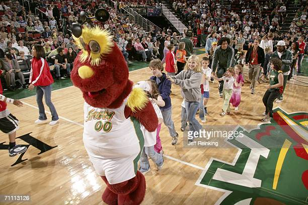 Seattle Storm mascot Doppler leads a conga line of fans during a timeout in the game against the Phoenix Mercury on June 2 2006 at Key Arena in...