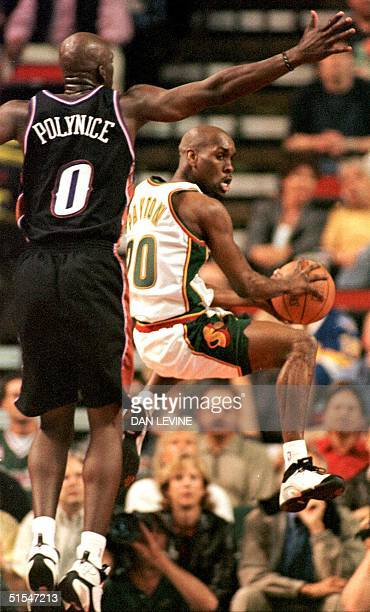 Seattle SuperSonic Gary Payton looks to dish off a pass in front of Utah Jazz Olden Polynice during first quarter action of their Western Conference...