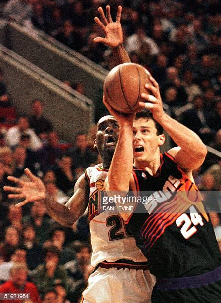 Seattle Supersonic Gary Payton tries to stop Phoenix Sun Tom Gugliotta during fourth quarter action of their game in Seattle WA 05 March Phoenix held...