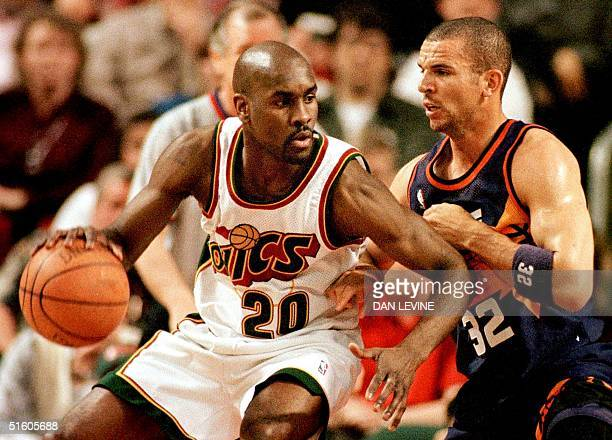 Seattle SuperSonic Gary Payton works his way toward the basket as Phoenix Sun Jason Kidd applies defensive pressure during first action of their game...