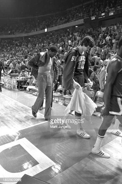 Seattle Supersonics Head Coach Bill Russell and Center Tom Burleson walk off the court following an NBA basketball game against the Denver Nuggets at...