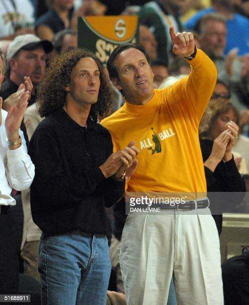 Seattle Supersonics owner Howard Schultz chats with jazz saxophone player Kenny G prior to his team's game against the San Antonio Spurs in Seattle...