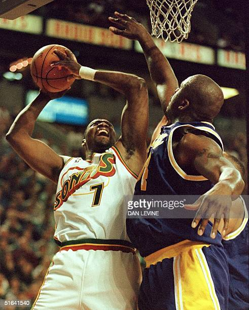 Seattle SuperSonics player Jerome Kersey launches a shot over Los Angeles Lakers player Shaquille O'Neal during first quarter play in their game in...