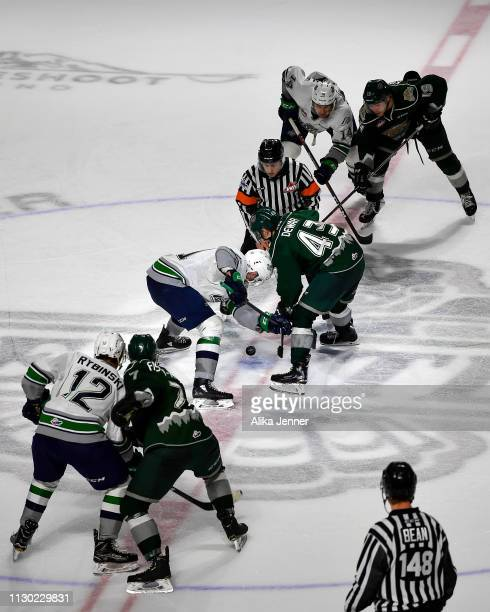 Seattle Thunderbirds and Everett Silvertips battle at the drop at accesso ShoWare Center on February 16 2019 in Kent Washington