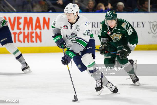 Seattle Thunderbirds captain Nolan Volcan skates the puck away from Everett Silvertips forward Reece Vitelli during a game between the Seattle...