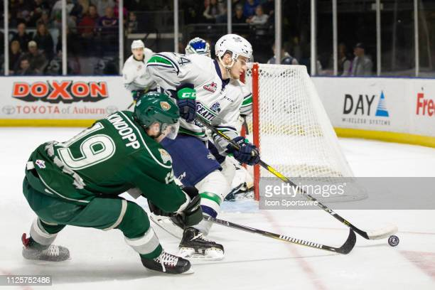 Seattle Thunderbirds defenseman Jake Lee keeps the puck out of reach from Everett Silvertips forward Bryce Kindopp in the first period during a game...