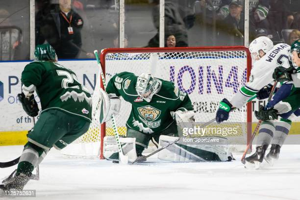 Seattle Thunderbirds forward Matthew Wedman tries to poke the puck past Everett Silvertips goaltender Dustin Wolf during a game between the Seattle...