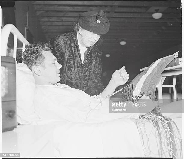 Mrs FDR Learns about Knots Mrs Eleanor Roosevelt pauses at the bed of J W Jones Electrician's Mate Third Class USN during a visit to the Seattle...