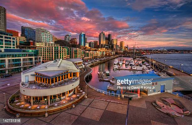 seattle waterfront at sunset - seattle stock pictures, royalty-free photos & images