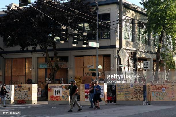 Seattle's abandoned East Precinct police station is seen surrounded by barricades in the so-called Capitol Hill Autonomous Zone. An area in Seattle's...