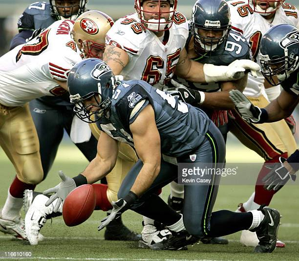 Seattle's Lofa Tatupu recovers a fumble by the 49ers in the second quarter during the San Francisco 49ers and Seattle Seahawks game at Qwest Field in...