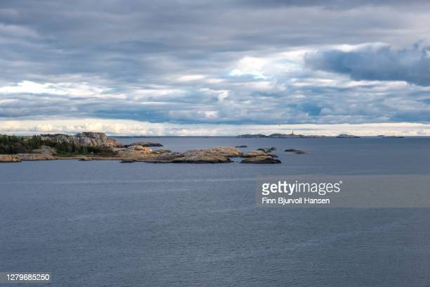 seaview at the coast of norway. svenner lighthouse in the horizon - finn bjurvoll stock pictures, royalty-free photos & images