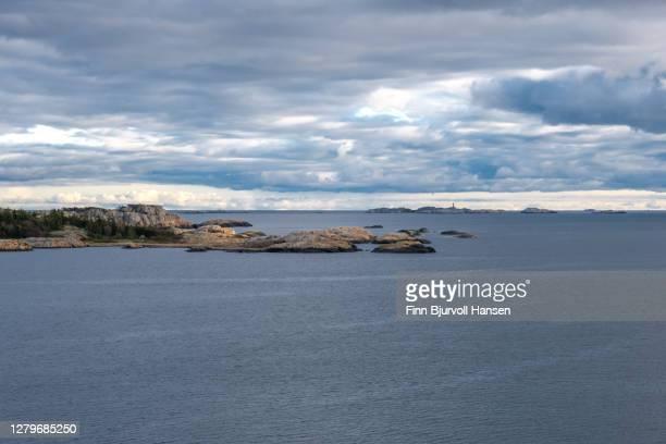 seaview at the coast of norway. svenner lighthouse in the horizon - finn bjurvoll ストックフォトと画像