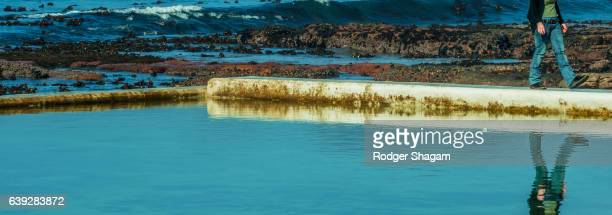 seawall at a tidal pool - seawall stock pictures, royalty-free photos & images