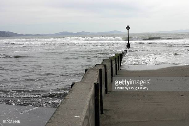 seawall at bolinas beach - seawall stock pictures, royalty-free photos & images