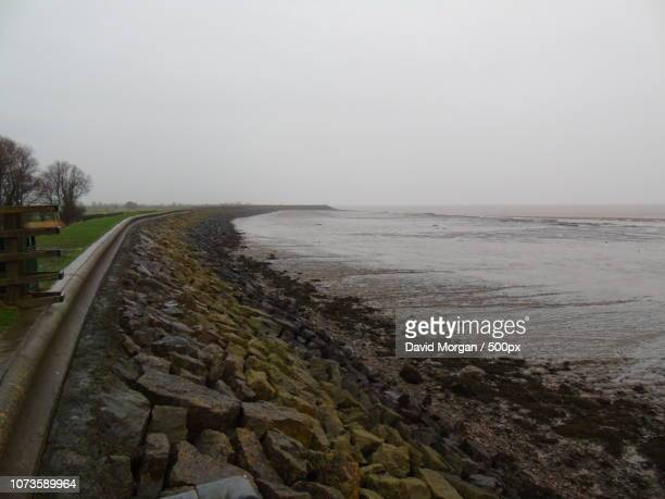 seawall near newport south wales - seawall stock pictures, royalty-free photos & images