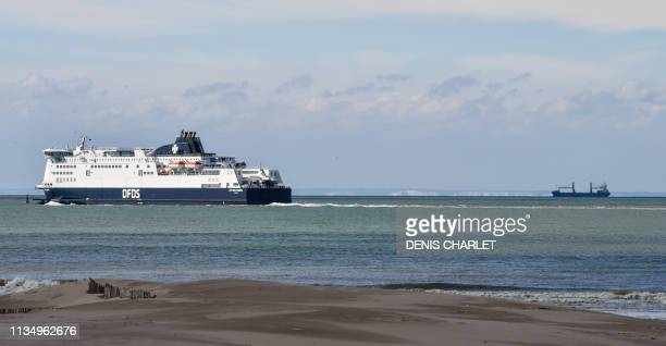 Seaways ferry sails across the Channel towards the White Cliffs of Dover seen from the Tardinghen beach near the northern French port city of Calais...