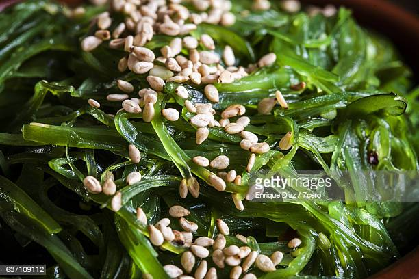 seaweed salad with sesame seeds - seaweed stock pictures, royalty-free photos & images