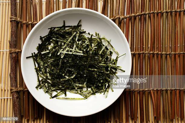 seaweed shreds in a white bowl