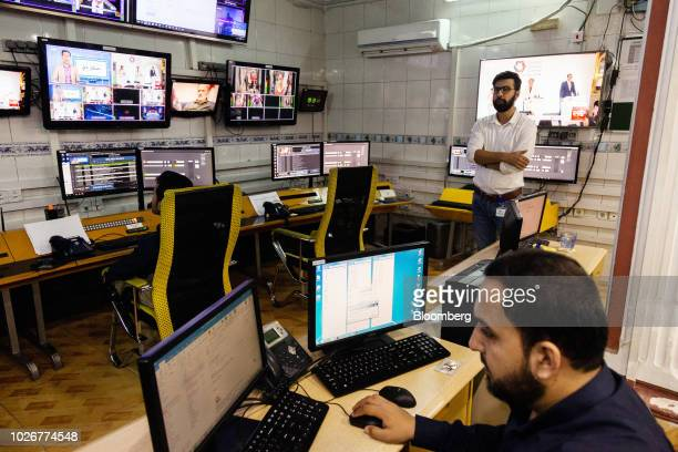 Seayer Ahadzada commercial director at Alef Technology background stands in the operations room of the company's office in Kabul Afghanistan on...