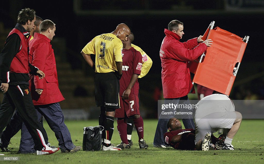 Seb Carole of Brighton & Hove Albion is given treatment during the Coca-Cola Championship match between Watford and Brighton & Hove Albion at Vicarage Road on December 3, 2005 in Watford, England.