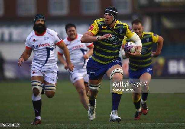 Seb Daies of Cardiff breaks clear of Josh Strauss of Sale during the European Rugby Challenge Cup Pool Two match between Cardiff Blues and Sale...