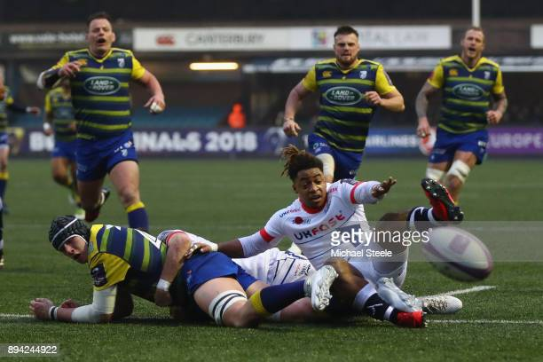 Seb Davies of Cardiff loses the ball on the try line after a challenge from Paolo Odogwu of Sale during the European Rugby Challenge Cup Pool Two...